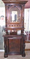 "an image of 19 5/8"" Polyphon music box with base cabinet"